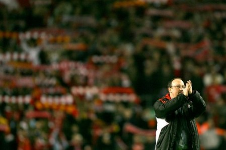 Rafa Benitez salutes the fans after the Arsenal victory
