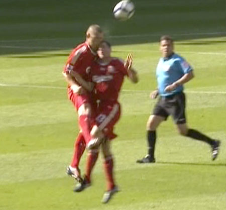 Skrtel and Carragher clash heads