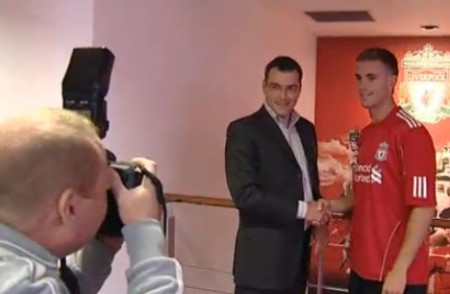 Henderson signs in at Anfield yesterday