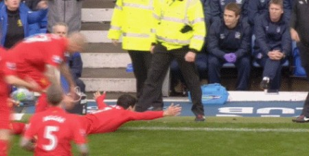 Suarez celebrates near the Everton dug out