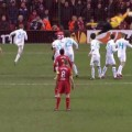 Luis Suarez scores a free kick against Zenit St Petersburg