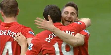 Fabio Borini celebrates a Liverpool goal