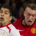 Suarez and Phil Jones exchange gurns