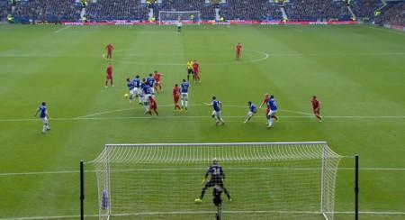 Suarez scores a free kick against Everton