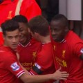 Raheem Sterling celebrates his second goal and Liverpool's 5th