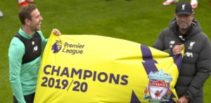 Klopp and captain Henderson are Premier League title winners